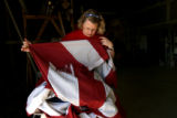 Amy Mayo (cq), of Show Your Colors Flag Company (2452 S. Trenton Way) checks an American flag for...