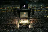 A video feed of Rudolph Giuliani (cq) is projected above the heads of approximately 19,000...