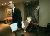 After the hearing Marc Holtzman's lawyer Mark Grueskin (reporter) pauses in the hallway as Bob...