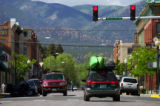 A car loaded with two boats sits at one of the few stop lights in the small town of Salida one...