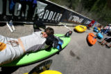 Dave Fusilli, cq, rest on his boat before his second heat in the Paddler Magazine Homestake Creek...