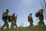 Marines from Buckley Air Force Base walk from one range to another range as they qualify in...