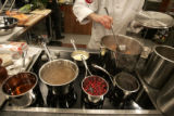 New York chef Joey Campanaro stirs stock during the Thanksgiving Food Network Challenge shot March...