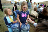Katie Siebert (cq, left), 6, and Taylor Kreiling (cq, right), 10, both of Littleton collect...