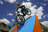 Dylan Korba (cq), 21, of Vancouver, B.C. drops in on a final ramp after riding off a bridge while...