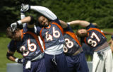[Centennial, CO - Shot on: 6/8/04]  O.J. Santiago, TE,(2nd from left) Stretches with his teammates...
