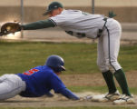 Denver, Colo., photo taken April 15, 2005- Cherry Creek's, Joey Mills(cq 5 left), avoids being...