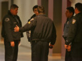 I unidentified teen is questioned by police after abandoning a back pack in a hallway during the...