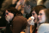 During a memorial service held at the Faith Bible Chapel, Julie Tiehen, far left, sobs while...