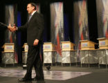 Republican presidential hopeful Mike Huckabee onstage before the Des Moines Register Republican...