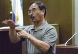 Gary Cacciatore, an interpreter for the deaf, signs for a defendant in court Tuesday, Nov. 20,...