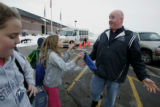 Ed Clark visits with students  waiting for a ride home at the end of the school day, during his...