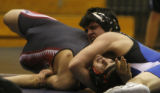 In 152 wt Bryce Lucherini (in blue) of Grandview pins Eaglecrest's Justin Rodriguez rat Grandview...