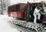 Lashawna Murphy, 36, of Baltimore, MD., gets a hand getting out of a snow cat to join other...