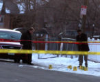 Denver Police  examine evidence markers lay in the middle of the 3200 block of W. Ada early...