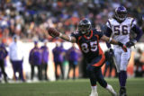 DM0018   Denver Broncos tight end Chad Mustard celebrates after picking up a first down in the...