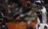 [ JPM503 ] Denver Broncos Elvis Dumervil reaches for the ball as Minnesota Vikings Tarvaris...