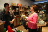 Melt employee, Joe Hendrickson, cq, helps customer Wendy Dilivio, cq, selected a scented soap...