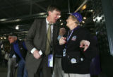 (Denver, Colo., April 4, 2005) Mayor John Hickenlooper talks with usher Nancy Goodyear while...