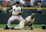 (DENVER shot on 4/4/05)   The San Diego Padres' Eric Young (#7) looks back for the umpires' call...