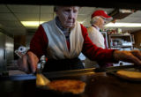 (from left) 87 year-old Fay Shepperd (cq) flips a burger as her daughter, 69 year-old Margaret De...