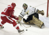 MIJM104 - Detroit Red Wings' Johan Franzen, left, of Sweden, fakes out Dallas Stars' goalie Marty...