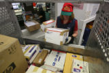 Maggie Lupton (cq) fills up one of the package bins at the Cherry Creek USPS office on one of the...