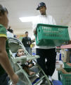 0152 Allen Iverson a gaurd for the Denver Nuggets, hands out over 100 holiday meals to needy...