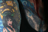 MJM243 Tattoos decorate the body of KHOW traffic reporter,  Susan Phelan (cq) of Lakewood, Colo....