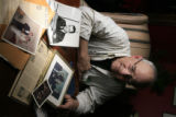 DM0131   Mike Jefferson looks over some old photographs of his brother Maj. Perry H. Jefferson and...