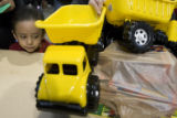 DM0002   Roberto Alvarez, 4, quietly waits his turn to receive a new toy truck during The Denver...