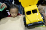 DM0003   Roberto Alvarez, 4, quietly waits his turn to receive a new toy truck during The Denver...