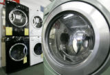 Stacy Getz looks at a high efficiency washing machine at Appliance Factory Outlet in Denver...