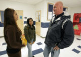 Ed Clark visits with students Megan Lessman , left and Sunisa Marcy right, during his rounds as...