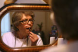 53 year-old Rita Airozo (cq), a resident at the Barth Hotel puts some lip-gloss before being...