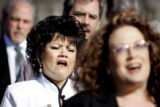 "(DENVER, Co. - SHOT 4/19/2005) Sandra Lee Ramirez (left) of Denver joins in singing ""Let..."