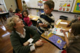 MJM081 First grade teacher, Elizabeth Frank (cq) talks with student, Sterling Ijam (cq), 7,...