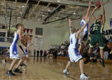 Aurora Central's Caston Mabin,right, shoots over Grandview's Andrew Abrahamson (4) and Tyler...