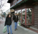 Eat!Drink!Shop! in Estes Park on November 29, 2007.  Scott and Shannon Boswell, of Lyons, walk...