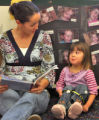 Teacher Shami Dillman (cq) reads to Isabelle May (cq) at the Jewish Community Center's Child...