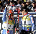 Teammates Didier Cuche SUI, left and Daniel Albrecht  SUI, celebrate a 1st and 3rd finish in the...