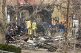 Adams County, Colo.-April 5 ,2005-   Investigators sift through the remains of a home at 5640...