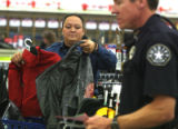 Deputy Amanda Cruz (cq) of the Arapahoe Sheriff Department  shops for clothes and  toys at Kmart...