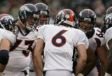 [JOE326] Denver Broncos offensive players lean into the huddle with quarterback Jay Cutler against...
