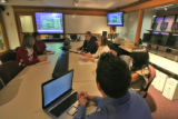 Students and administrators go over marketing ideas inside the Marsico Investment Center at the...