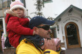 Hector Camacho (cq) carries his one year old daughter Ximena Camacho, in the streets of Vail...