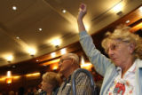 68 year-old Barbara Freier (cq) raises her hand to ask detectives a question, regarding the issue...