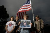 DLM1400  JoAnn Gillespie holds a photograph of her son Master Sgt. Randy J. Gillespie, 44, of...