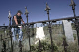 Andy Romero (cq), 35, looks at the graves of his great-great-great-grandparents' Dario and Eloria...