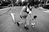 Angelina Ortiz (cq), 16, runs with neighbor Alysa DeHerrera (cq), 2, right, while mom Katrina...